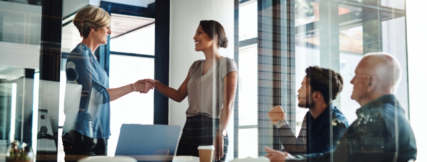 new hire shaking hands with manager