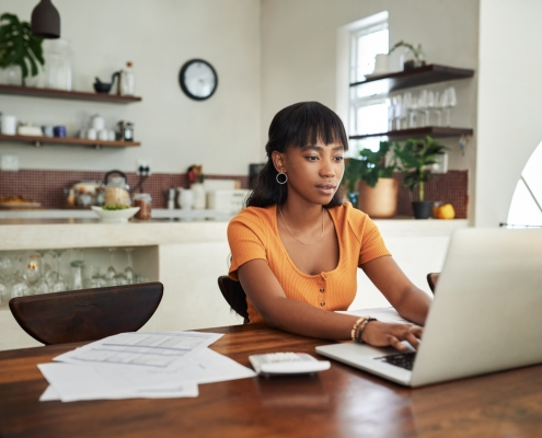 woman who is a remote worker sitting at a computer