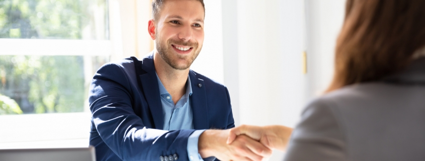 small business owner hiring an accountant and shaking hands