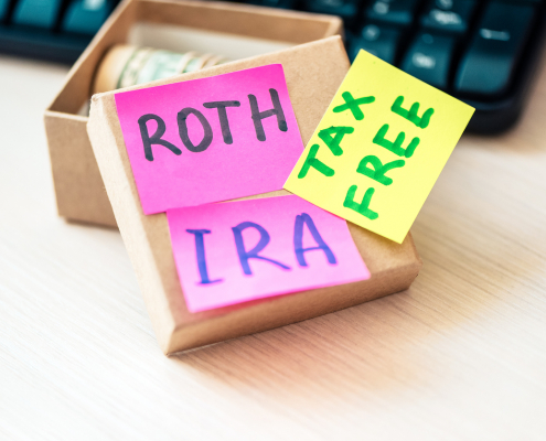 box of money with Roth IRA Tax Free written on sticky notes