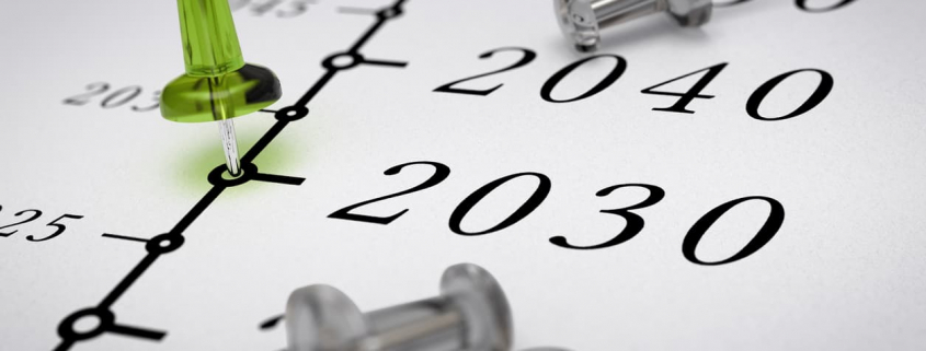 tacks on a calendar indicating future business planning