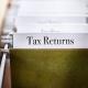 tax returns file folder in a file cabinet
